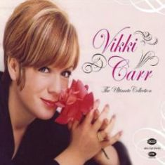 Go to Vikki Carr Page to hear Love Me With All Your Heart in Spanish.