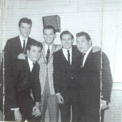 Paul Giacalone and The Fireflies with Dick Clark.  Paul is in front to left of Dick Clark.