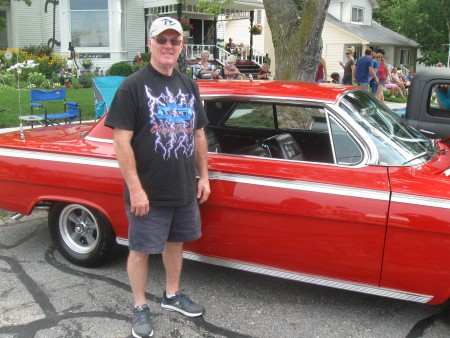 Owner Tim Pearcy with his Roman Red 1962 Chevy.
