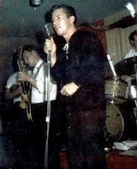 Gene Thomas on stage around 1960