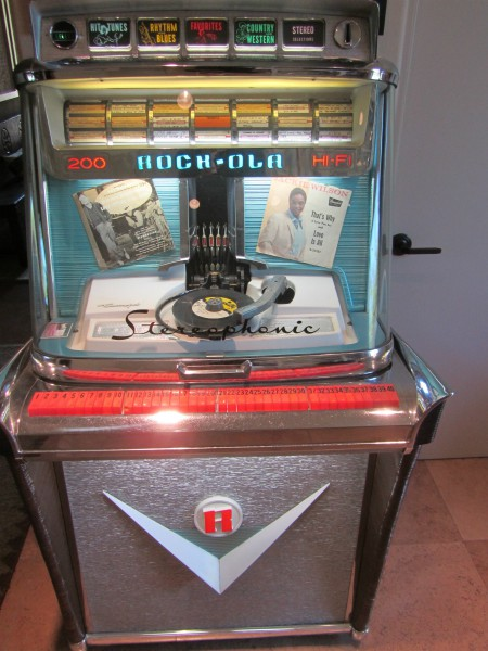Click on jukebox link or photo to expand then arrows to expand to view Jackie Wilson picture on record. 1959 Rockola Jukebox.