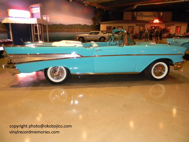 Visit the Toby Shine Okoboji Classic Cars museum, where cars like this classic 1957 Chevy are available for purchase.