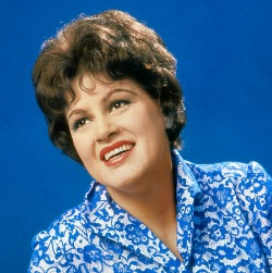 Patsy Cline sings with The Jordanaires in the background. The best cover ever on You Belong to Me.