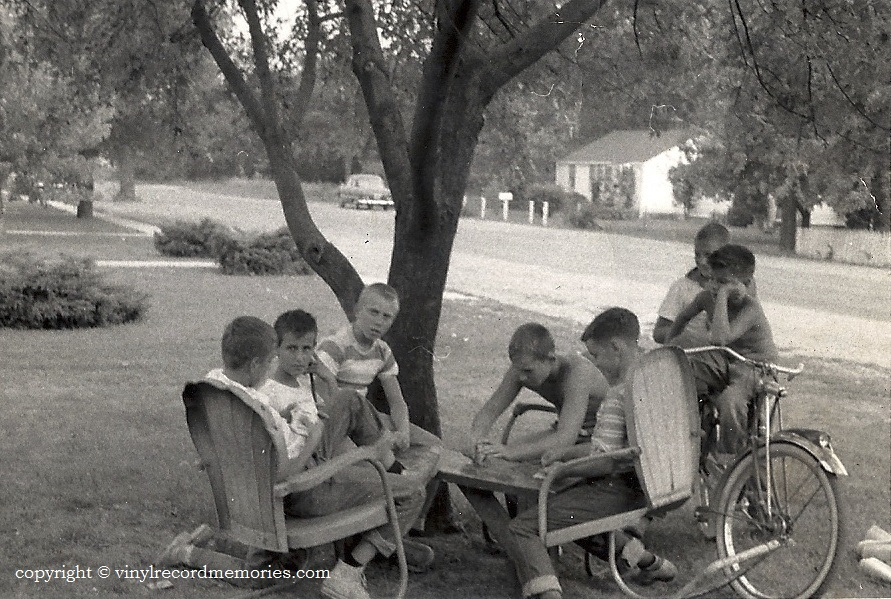 A hot Saturday afternoon with friends on St. Claire ave near Furhman's grocery in the Lindenwald area Hamilton, Ohio...crica, late fifties.