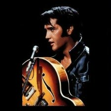 Elvis holding the Gibson Sunburst Super 400 CES, the one he plays on the '68 Special.