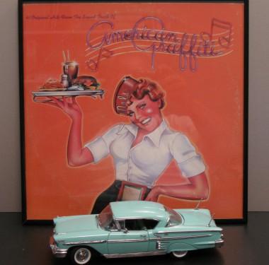 My original American Graffiti album and classic '58 Chevy Impala Danbury Mint collectible, both purchased new.