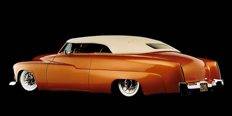 1951 Mercury Custom know as - Sundance - Dick Dean Custom. Carson top, 4 corner air ride, House of Kolor 7 stage custom orange paint, Chevy 350 engine, Neon underbody lighting & Cadillac wheel covers.